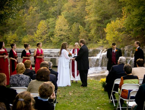 The couple exchanges vows overlooking the falls.