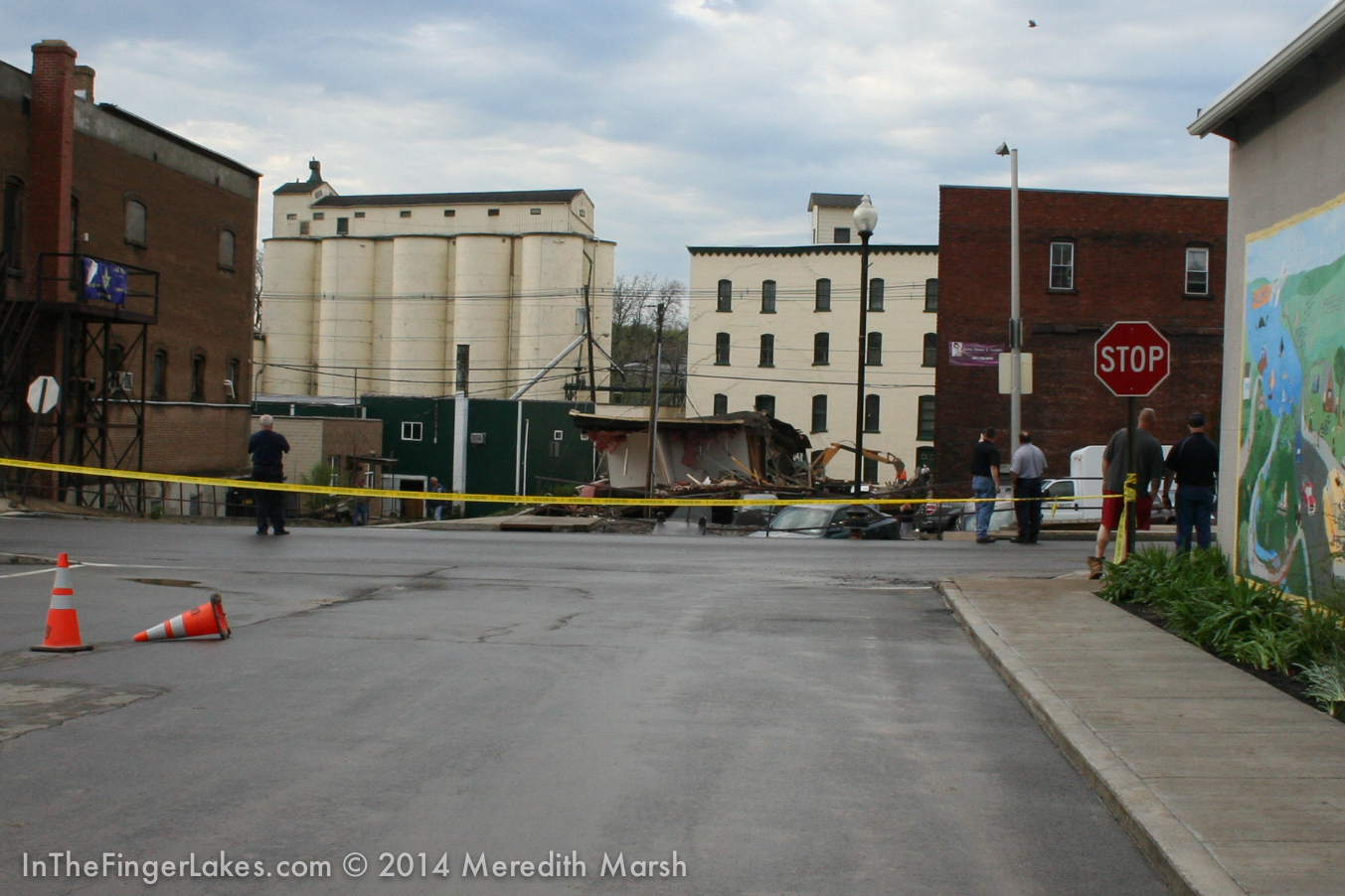 The Parking Lot behind Cam's Pizza on East Elm Street & Basin St. and the rear of the Owl's Nest